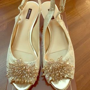 Gold ladies sling back dress shoe with low herl